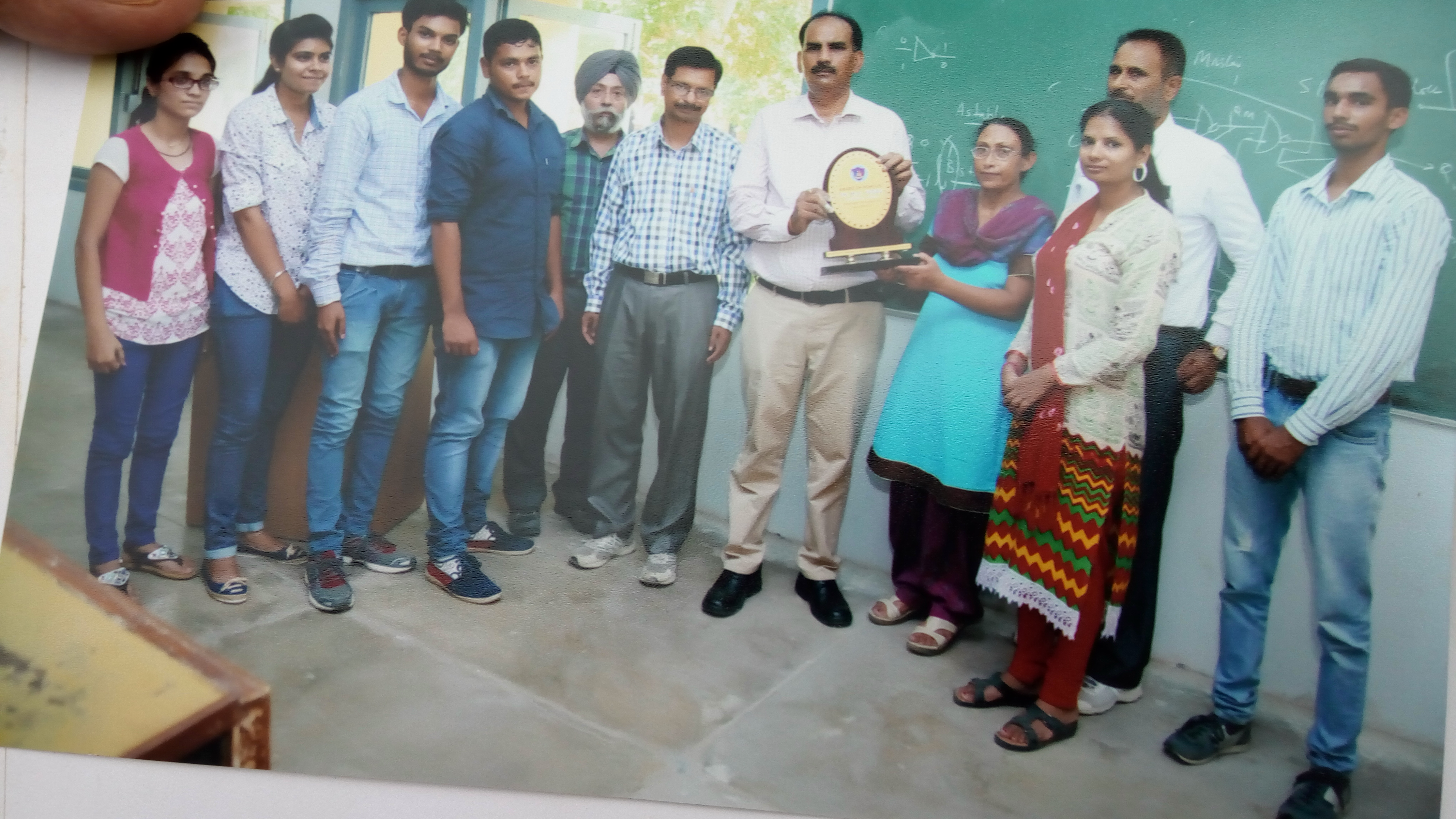Memento presentation to Dr. M.S. Yadav by the members of Science and Environment Society