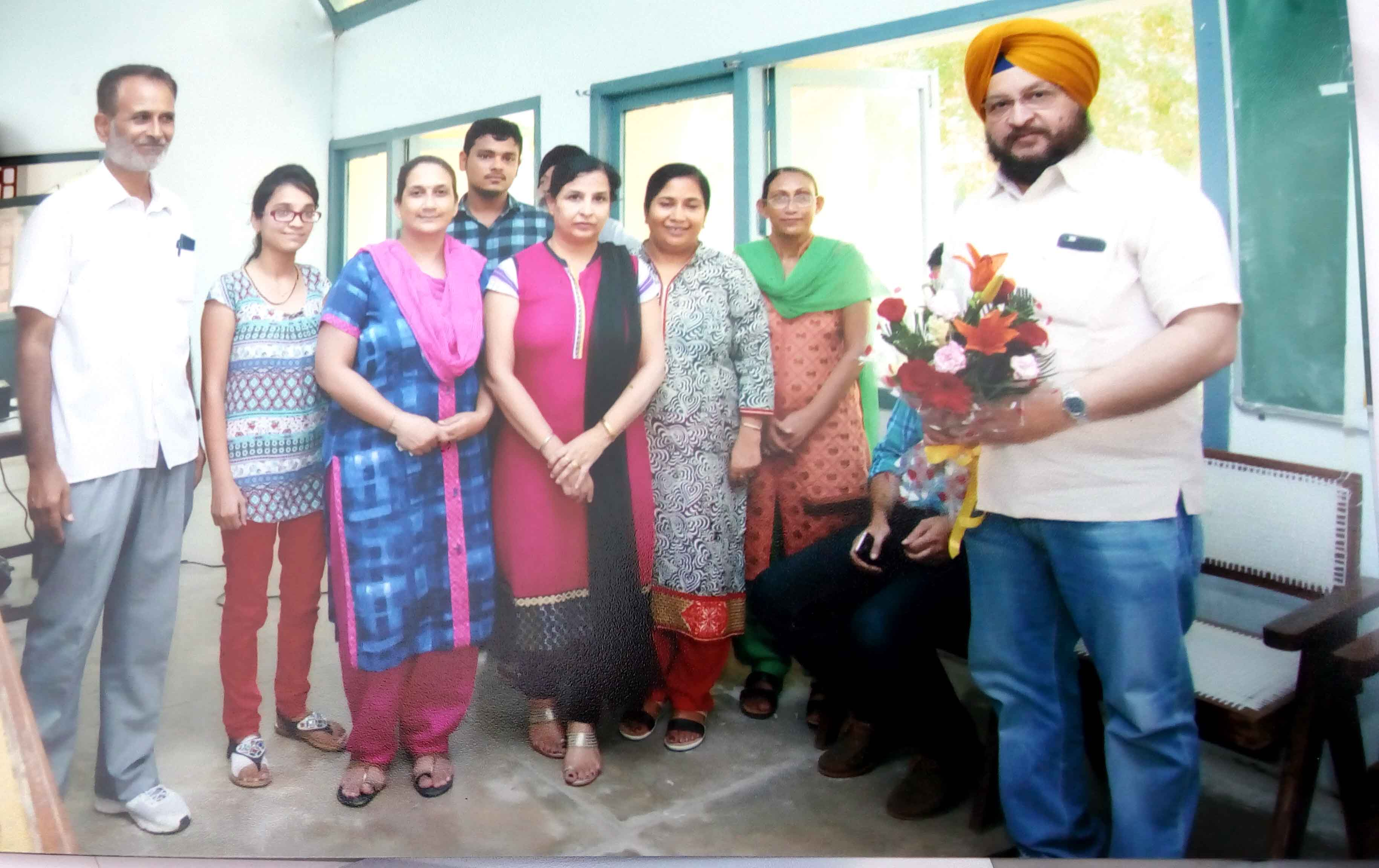 Bouquet presentation to Dr. Sarbjit Singh, District Governor Rotory District 3070